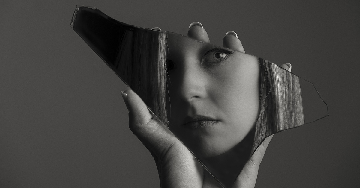 Woman Holding Shard of Glass